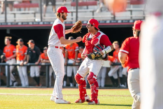 UL pitcher Brandon Young, left, and catcher Sebastian Toro, right celebrate Saturday's 1-0 complete-game shutout win over Sam Houston  State at The Tigue.