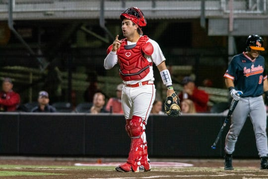 "UL catcher Sebastian Toro talks to teammates during a game against Sam Houston State last Friday night on M.L. ""Tigue"" Moore Field at Russo Park."