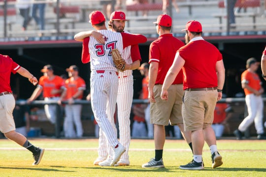 UL pitcher Brandon Young (facing camera), a 2020 MLB Draft prospect, is congratulated after beating Sam Houston State 1-0 in a complete game last February.