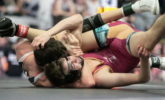 Travis Richardson of Brighton pinned Davison's Owen Payne at 119 pounds in the state Division 1 team semifinals on Saturday, Feb. 29, 2020 in Kalamazoo.