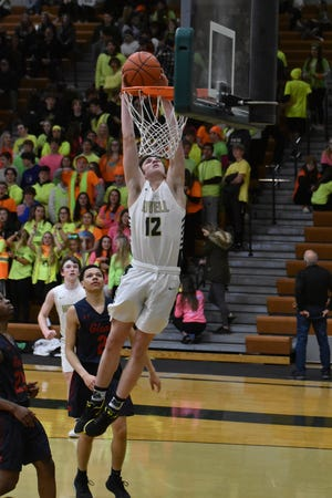 Howell's Tony Honkala dunks home two of his 15 points in a 59-47 victory over Westland John Glenn on Friday, Feb. 28, 2020.
