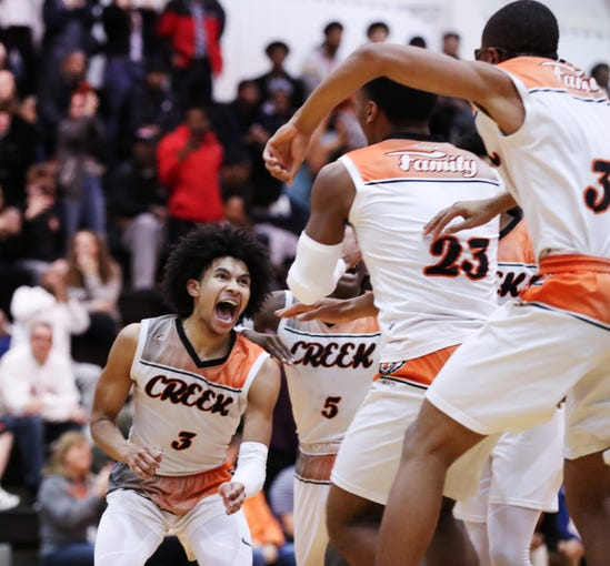 Fern Creek's Jaden Rogers (3) celebrated with teammates during their victory over Jeffersontown in the 24th District final at Mercy Academy in Louisville, Ky. on Feb. 28, 2020.