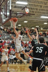 Shelby's Cody Lantz drives for two of his 19 points in Friday's sectional title win over Clear Fork