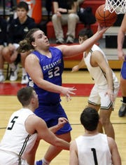 (NJ)-Crestline High School's Ethan Clark (52) drives in past South Central High School's Isaiah Seidel (5) for a layup during high school boys basketball action Friday at Crestview High School.