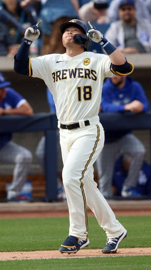 Keston Hiura of the Brewers points skyward after hitting a two-run homer during the fourth inning against the Dodgers.