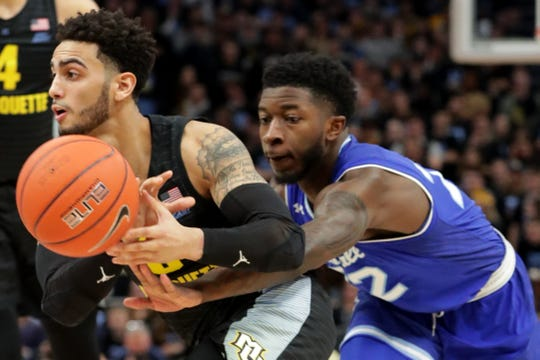 Seton Hall guard Myles Cale knocks the ball away from Marquette guard Markus Howard.