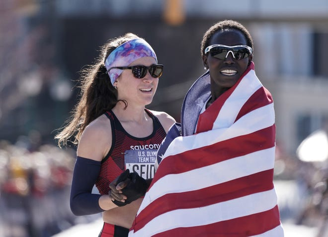 Feb 29, 2020; Atlanta, Georgia, USA; Aliphine Tuliamuk (right) and Molly Seidel embrace after placing first and second in the women's race during the US Olympic Team Trials marathon. Mandatory Credit: Kirby Lee-USA TODAY Sports