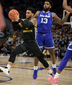Marquette's Markus Howard and Seton Hall's Myles Powell (right) will play in the Big East quarterfinals on Thursday.