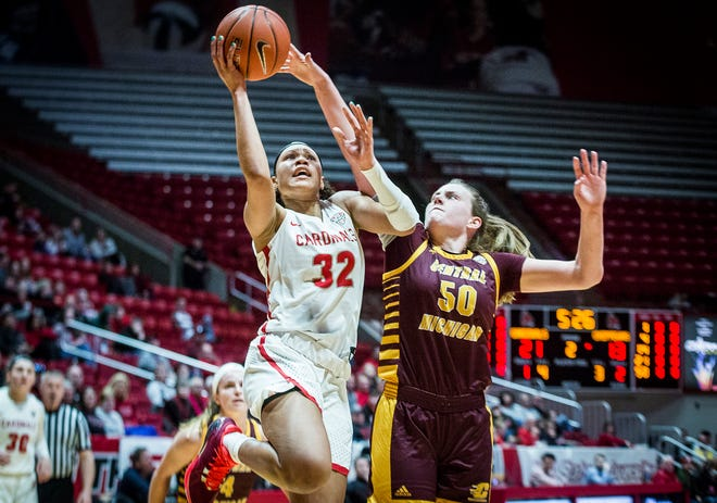 FILE -- Ball State's Oshlynn Brown shoots past Central Michigan's defense during their game at Worthen Arena Saturday, Feb. 29, 2020.