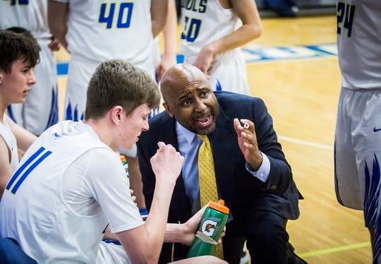 Burris coach Joseph Anderson talks to his team during their game against Delta at Burris High School Friday, Feb. 28, 2020.