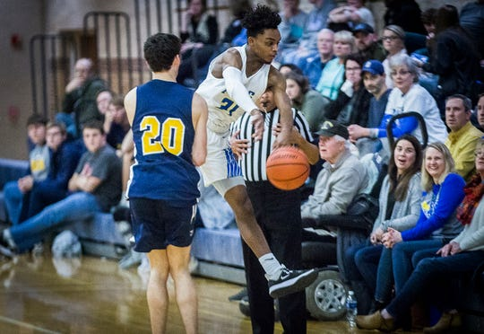 Burris senior Javon Dixon hustles for a ball while going out of bounds during a game against Delta at Burris High School Friday, Feb. 28, 2020.