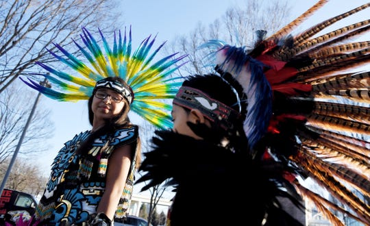 Aztec dancers Janet Olmos, 11, and Erick Olmos, 7, perform for the La Brigada De Oro fan club before the debut of Nashville SC at Nissan Stadium in Nashville, Tenn., on Saturday, Feb. 29, 2020.