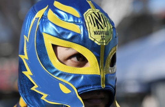 Nestor Misterio of La Brigada De Oro fan club wears a mask before the debut of Nashville SC at Nissan Stadium in Nashville, Tenn., on Saturday, Feb. 29, 2020.