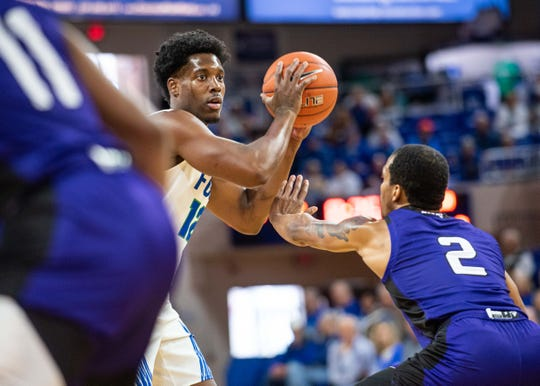 FGCU guard Malik Hardy looks to pass against North Florida on Saturday at Alico Arena.