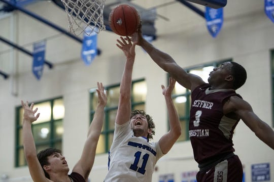 Community School of Naples Jay Beshears, has his shot blocked by Seffner Christian's Mike Trigg, Friday, Feb. 28, 2020, at Moe Kent Family Field House in North Naples.
