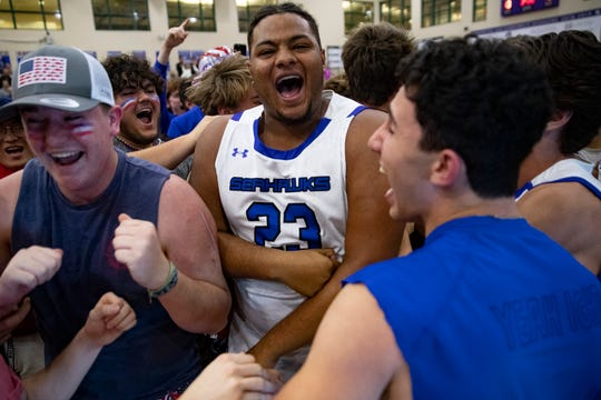 Community School of Naples' Damon Donalds, center, celebrates his teams win with his classmates after their game against Seffner Christian, Friday, Feb. 28, 2020, at Moe Kent Family Field House in North Naples.