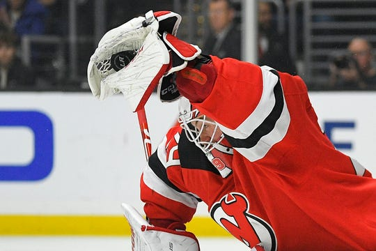 New Jersey Devils goaltender Mackenzie Blackwood makes a glove save during the second period of an NHL hockey game against the Los Angeles Kings Saturday, Feb. 29, 2020, in Los Angeles.
