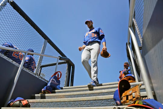 New York Mets pitcher Steven Matz walks down the dugout steps as he prepares to start a spring training baseball game against the Houston Astros Saturday, Feb. 29, 2020, in West Palm Beach, Fla.