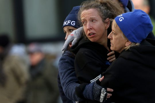Roberta Groner gets a hug from her mother, Angie Consolo, of Pittsburgh, while watching other runners go by after dropping out of the race, due to pain. Saturday, February 29, 2020
