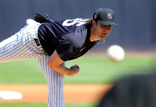 Feb 29, 2020; Tampa, Florida, USA; New York Yankees starting pitcher Gerrit Cole (45) throws a pitch during the first inning against the Detroit Tigers at George M. Steinbrenner Field.