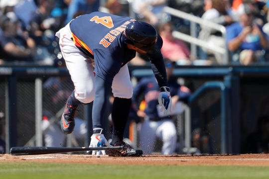 Houston Astros' George Springer stumbles as he runs out of the batter's box grounding out during the first inning of a spring training baseball game against the New York Mets Saturday, Feb. 29, 2020, in West Palm Beach, Fla.