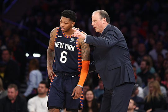 Feb 29, 2020; New York, New York, USA; New York Knicks head coach Mike Miller talks with guard Elfrid Payton (6) during the second quarter against the Chicago Bulls at Madison Square Garden. Mandatory Credit: Vincent Carchietta-USA TODAY Sports