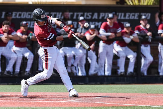 NMSU junior NickGonzales takes a swing at the plate as the New Mexico State Men's Baseball team faces off against Purdue Fort Wayne in the first game of a doubleheader at Presley Askew Field in Las Cruces on Saturday, Feb. 29, 2020.