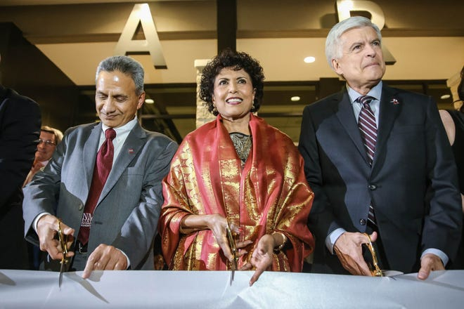 Ammu Devasthali (center), Dr. Ramakrishna Devasthali (left) and NMSU chancellor Dan Arvizu attend a ribbon cutting for Devasthali Hall, the new home for New Mexico State University's Department of Art and University Art Museum in Las Cruces on Friday, Feb. 28, 2020.