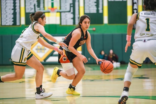 The Mayfield Trojans girl's basketball team face off against the Centennial Hawks during the district championship at Mayfield High School in Las Cruces on Friday, Feb. 28, 2020.