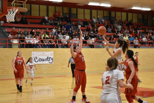 Loving forward Faith McDonald contests and alters Eunice guard Denise Rangel's floater in the third quarter. Eunice won in overtime, 48-40.