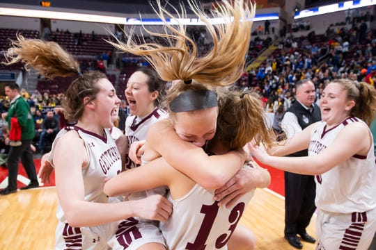 Gettysburg's Anne Bair leaps into the open arms of Lily Natter (13) as the Warriors celebrate their District 3 Class 5A championship win over Twin Valley in Hershey on Friday, Feb. 28, 2020. The Warriors won, 46-40.