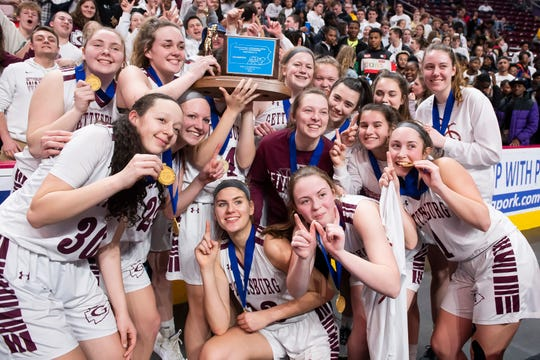 The Gettysburg Warriors pose with their district trophy after defeating Twin Valley 46-40 in Hershey on Friday, Feb. 28, 2020.