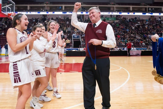 Gettysburg head coach Jeff Bair gives the student section a fist pump before the start of the medal ceremony on Friday, Feb. 28, 2020.