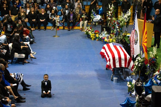 Gabriel Kellywood, 5, sits on the floor during his dad's funeral on Feb. 29, 2020, at the Chief Alchesay Activity Center in Whiteriver, Arizona.