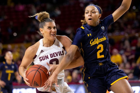 Arizona State's Taya Hanson drives to the basket against California's Cailyn Crocker in the first half on Feb. 28, 2020, at ASU Desert Financial Arena in Tempe, Ariz.