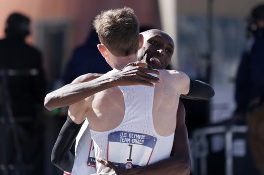 43-year-old Abdi Abdirahman of Tucson, hugging Galen Rupp, made his fifth Olympic team Saturday by finishing third in the men's race at the U.S. Olympic Marathon Trials. Rupp was the champion.
