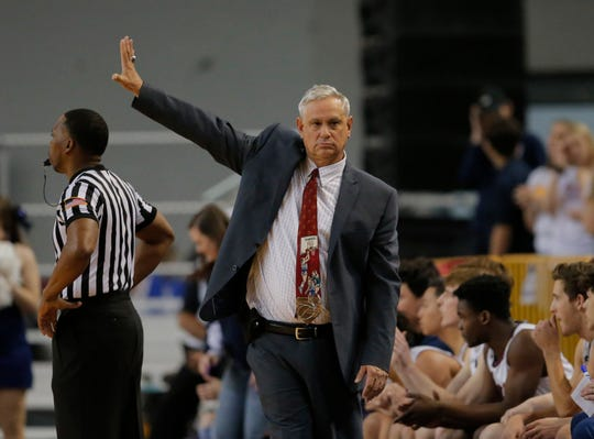 Scottsdale Christian Academy head coach Bob Fredericks signals to his team during a 2A boys basketball state semifinal game against Trivium Prep at Arizona Veterans Coliseum in Phoenix, Ariz. on February 28, 2020.