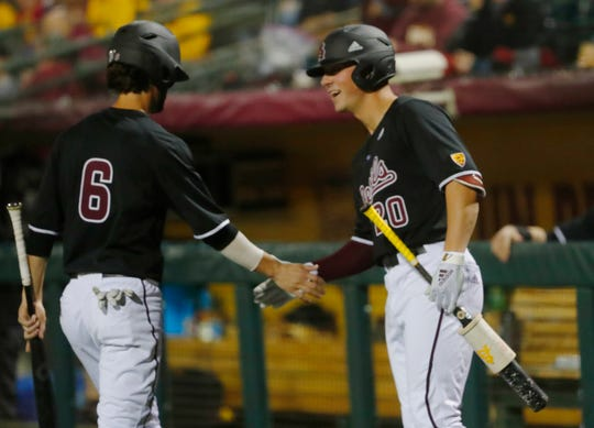 ASU's Drew Swift (6) celebrates scoring with teammate Spencer Torkelson (20) during the second inning at Phoenix Municipal Stadium  in Phoenix, Ariz. on Feb. 28, 2020.