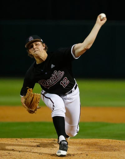 ASU's Cooper Benson (12) pitches in the first inning to Nebraska's Jaxon Hallmark (2) during the first inning at Phoenix Municipal Stadium  in Phoenix, Ariz. on Feb. 28, 2020.