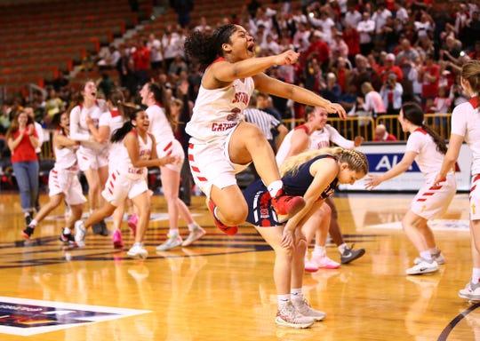 Seton Catholic Preparatory guard Lee Willis (3) jumps for joy after defeating Sahuaro High to win the 4A Girls basketball championship at Veterans Memorial Coliseum on Feb. 29, 2020 in Phoenix, Ariz.