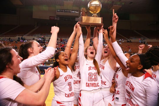 Seton Catholic Preparatory celebrates after defeating Sahuaro High to win the 4A Girls basketball championship at Veterans Memorial Coliseum on Feb. 29, 2020 in Phoenix, Ariz.