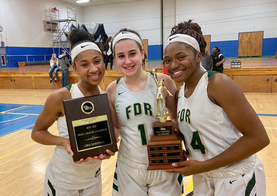 Franklin D. Roosevelt girls basketball players Deliah Smith (left), Kelsea Demelis and Jaelen Daubon pose with the Mid-Hudson Athletic League championship trophy and plaque on Feb. 28.