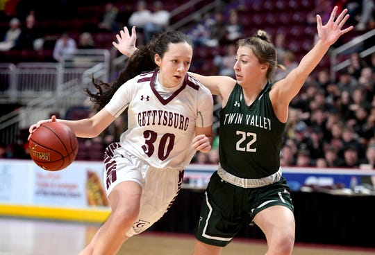 Gettysburg's Cheyenne Proctor drives against Twin Valley's Anna Kaplan in the District 3 Class 5-A girls' basketball title game at the Giant Center Friday, Feb. 28, 2020. Bill Kalina photo