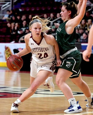 Gettysburg's Anne Bair, seen here at left in a file photo, has committed to play NCAA Division I basketball at Manhattan College.