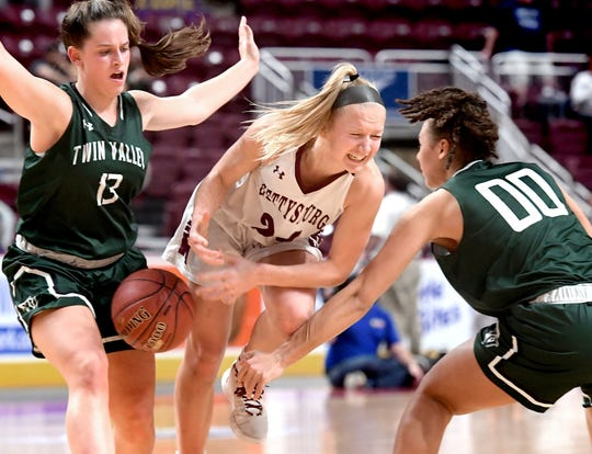 Gettysburg's Anne Bair draws a foul driving against Twin Valley's Natali Foster, left, and Peyton McDaniel in the District 3 Class 5-A girls' basketball title game at the Giant Center Friday, Feb. 28, 2020. Gettysburg won 46-40. Bill Kalina photo