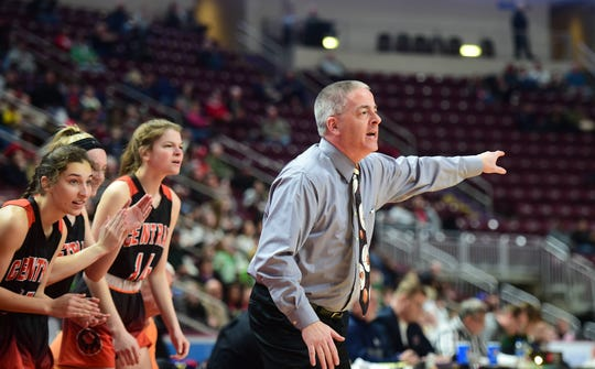 Central York head coach Scott Wisner gives him team instructions after the Panthers cut their deficit to four points in the fourth quarter Saturday. Central Dauphin defeated Central York, 40-36, in the District 3 Class 6A title game at Hershey's Giant Center Saturday.