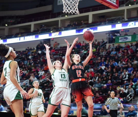 Central York freshman Bella Chimienti goes up for a layup against Central Dauphin's Audrey Weigl. Central Dauphin defeated Central York, 40-36, in the District 3 Class 6A title game at Hershey's Giant Center Saturday.