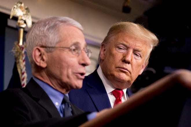 National Institute for Allergy and Infectious Diseases Director Dr. Anthony Fauci, left, accompanied by President Donald Trump, speaks about the coronavirus during a news conference in the press briefing room at the White House on Feb. 29 in Washington.