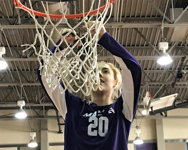 Mason High School's Tristin Keller helps cut down the net after beating San Saba 33-32 in the Region IV-2A championship in San Marcos on Saturday, Feb. 29, 2020. The Cowgirls will make their third straight appearance in the UIL state tournament.