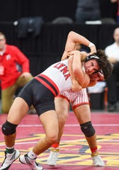 Brandon Valley's Damion Schunke and Chamberlain's Jasiah Thompson compete in the class A-152 state wrestling semifinals on Friday, Feb. 28, at the Denny Sanford Premier Center in Sioux Falls.